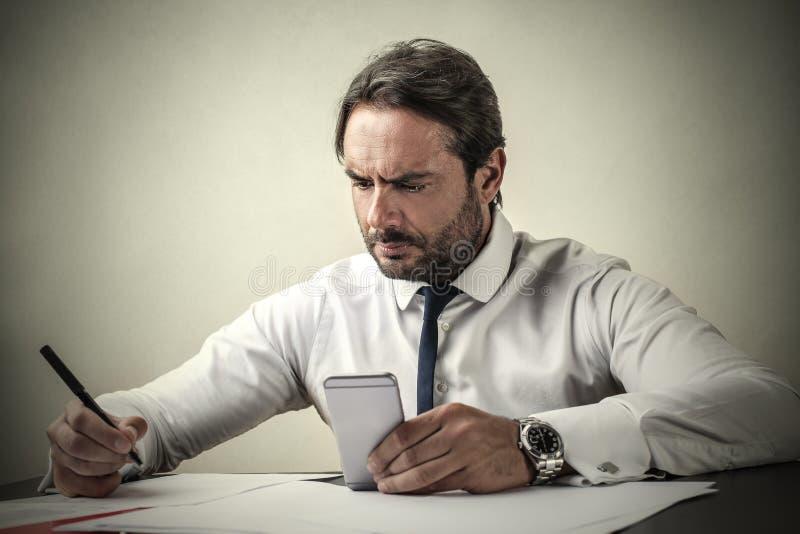 сконцентрированный бизнесмен стоковая фотография rf
