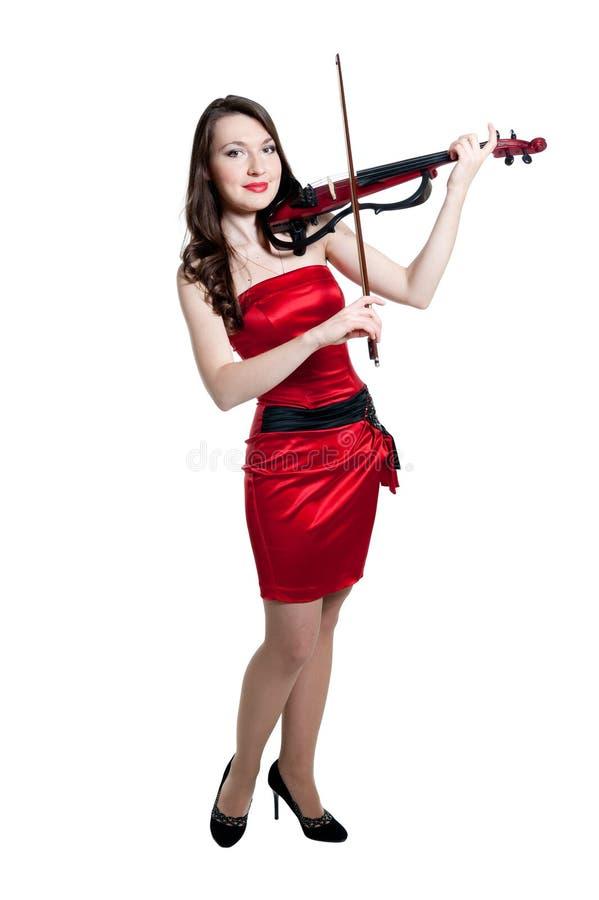 скрипач красного цвета девушки платья стоковое фото