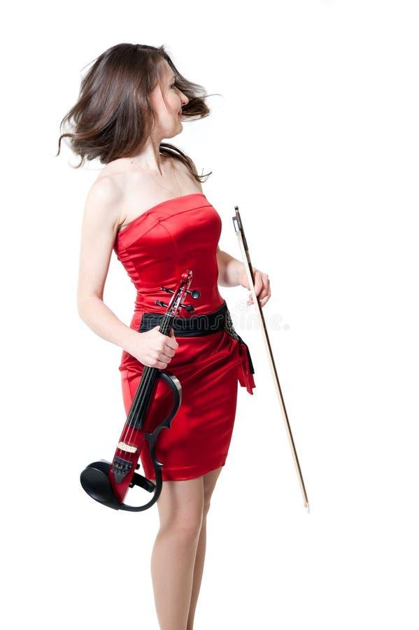 скрипач красного цвета девушки платья стоковые изображения rf