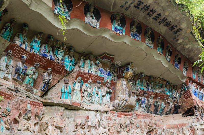 Скульптура на резном изображении утеса Dazu на держателе Baoding или Baodingshan в Dazu, Чунцине стоковые фотографии rf