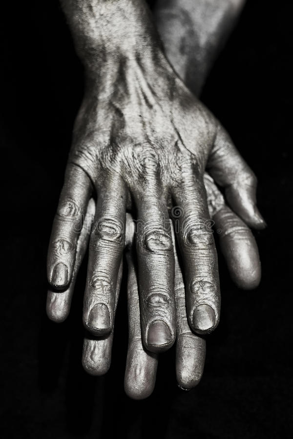 Скульптурные руки мужчины металла стоковое фото