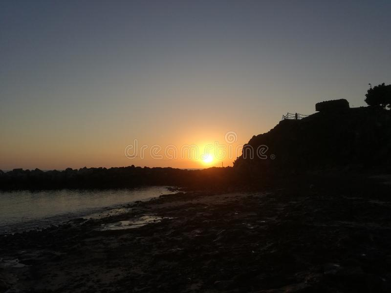 славный заход солнца стоковые изображения