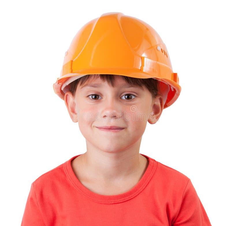Сладостная девушка в шлеме здания стоковые фото