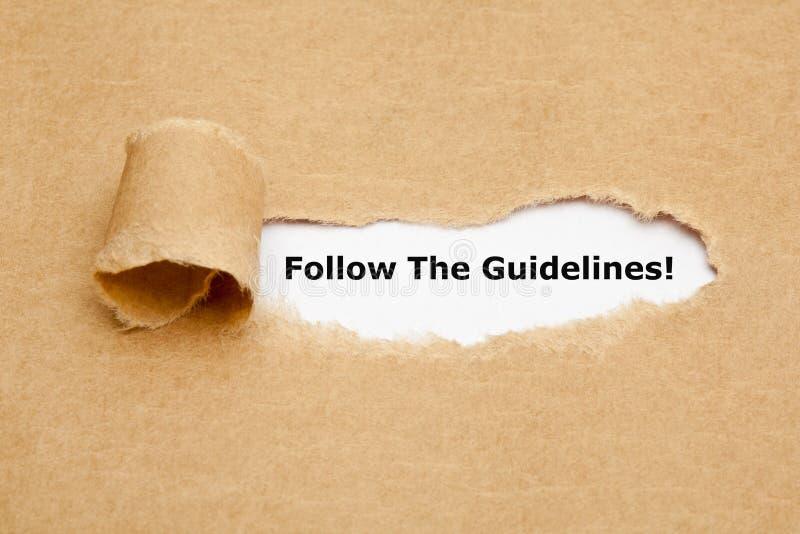Следовать бумагой сорванной директивами стоковое фото rf
