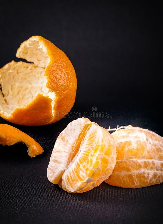 Слезли оранжевые цитрусовые фрукты Клементина стоковые изображения