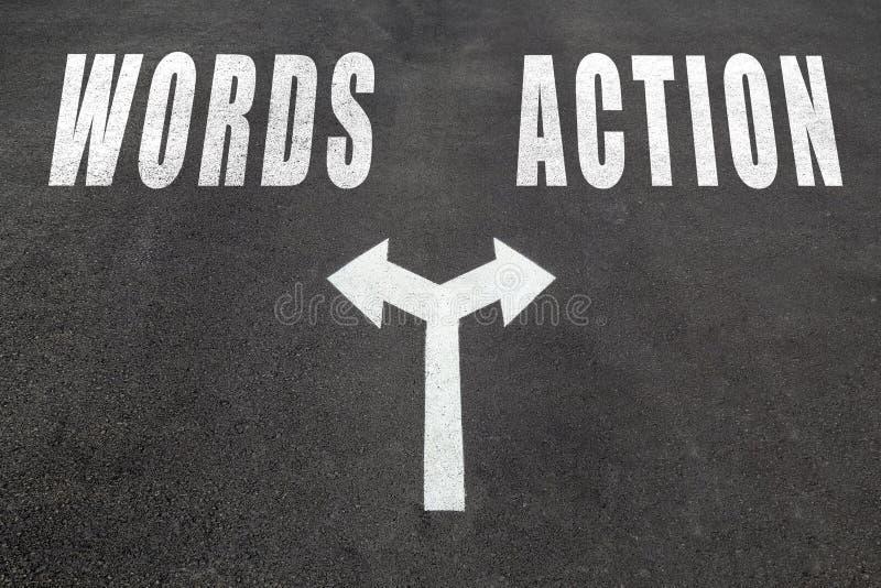 Слова против концепции выбора действия стоковая фотография rf
