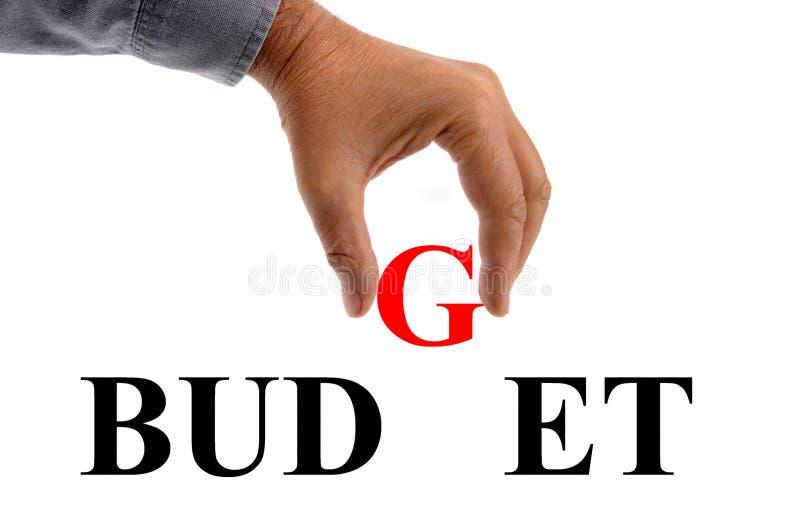 Слово бюджета сочинительства руки с письмами алфавита на белой предпосылке иллюстрация штока
