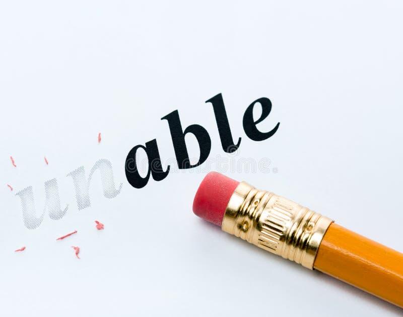 Слово неспособное и карандаш стоковые фотографии rf