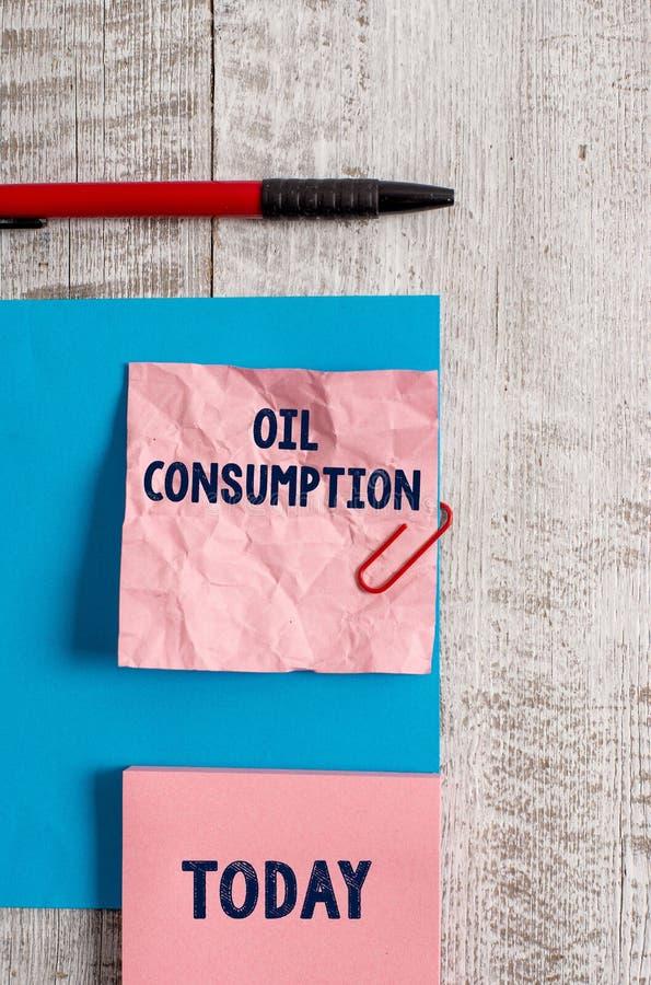 Слово писать потребление нефти текста Концепция дела для этого входа полное масло уничтоженное в бочонках в морщинку дня стоковая фотография