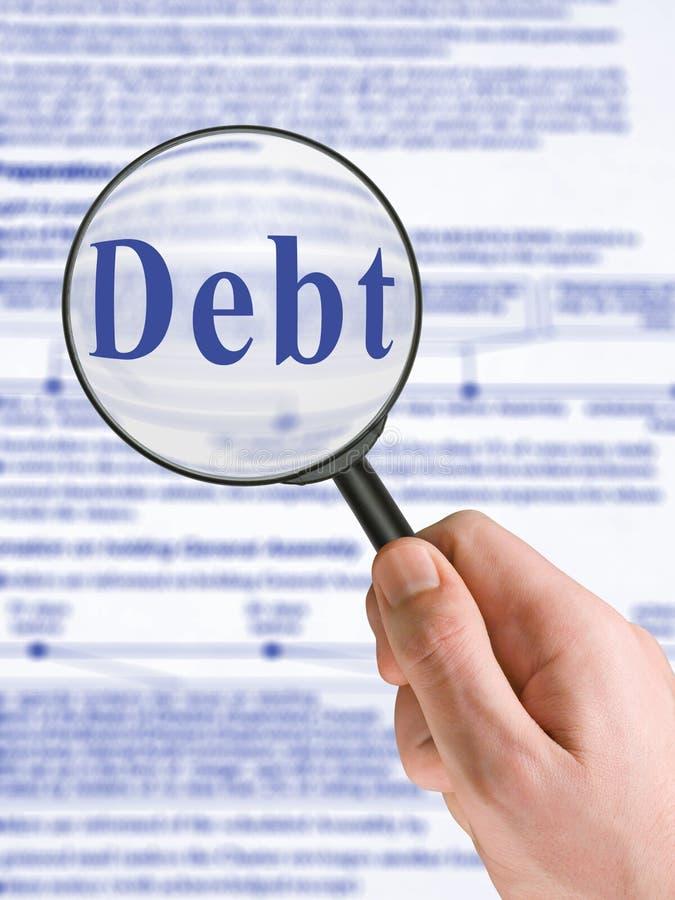 слово стеклянной руки задолженности увеличивая стоковые фото