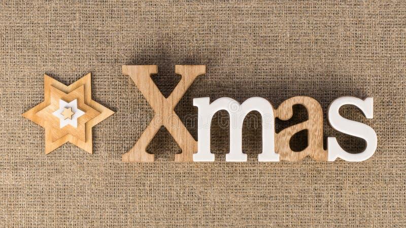 Слово XMAS с декоративными звездами стоковое фото