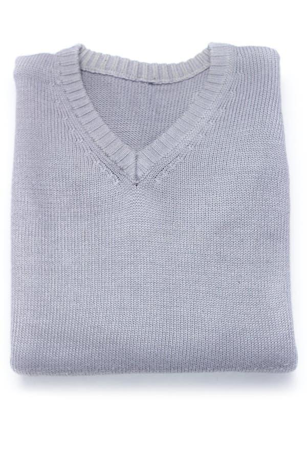Сложенный теплый свитер на белой предпосылке, взгляде сверху стоковая фотография rf