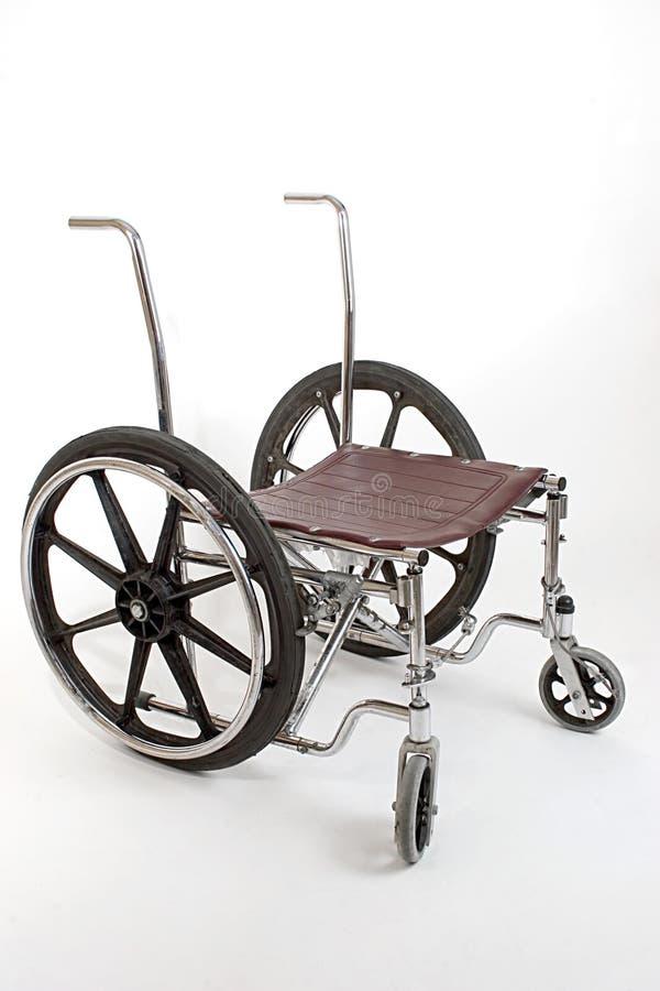 сломано вниз с кресло-коляскы стоковая фотография