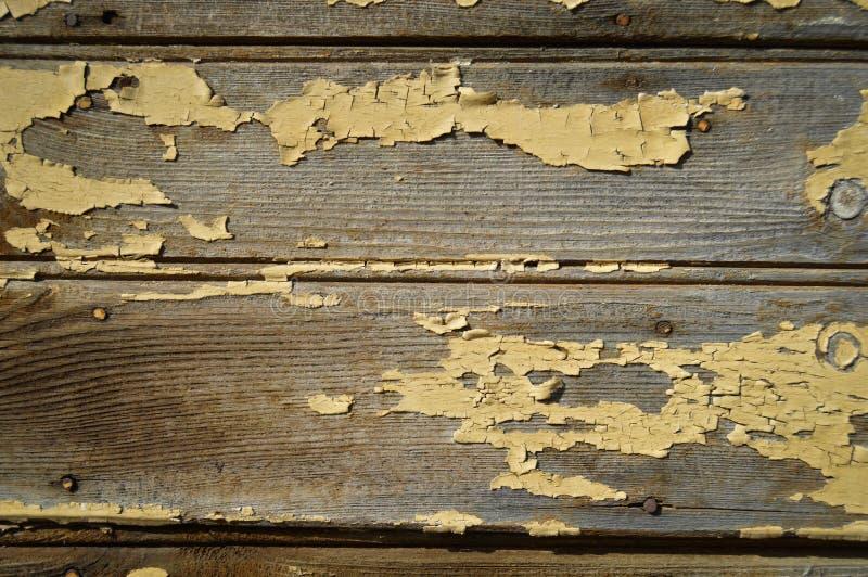 Сломленная старая краска на деревянной панели стоковые фотографии rf