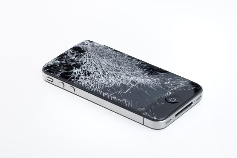 Сломленное iPhone 4 Яблока стоковые изображения