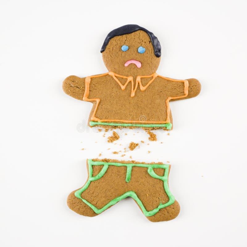 сломленный человек gingerbread стоковое фото