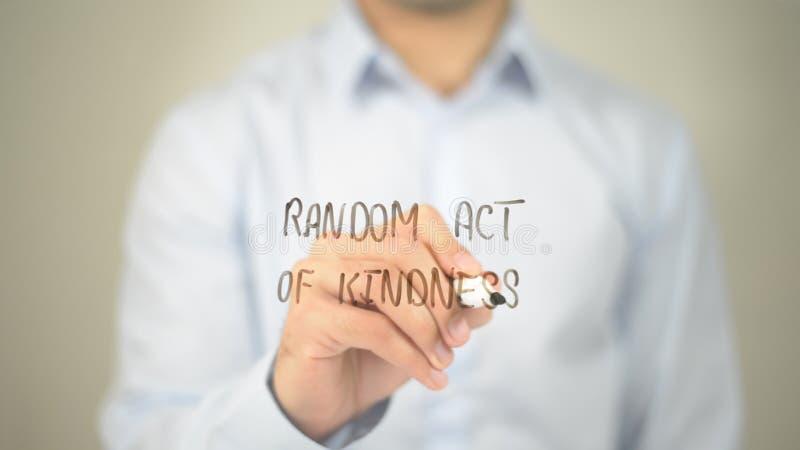 Случайный поступок доброты, сочинительства человека на прозрачном экране стоковые изображения rf