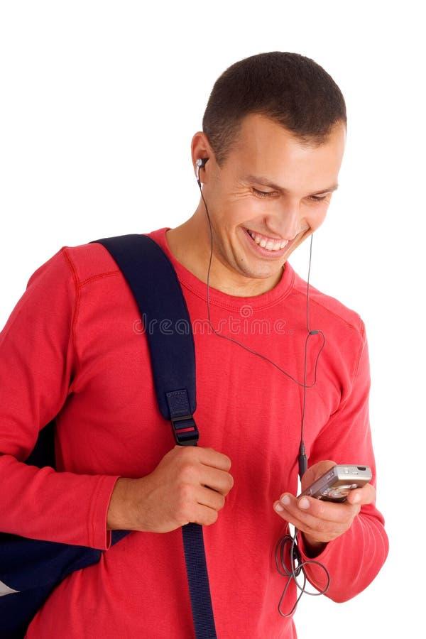 слушая детеныши студента нот стоковое изображение