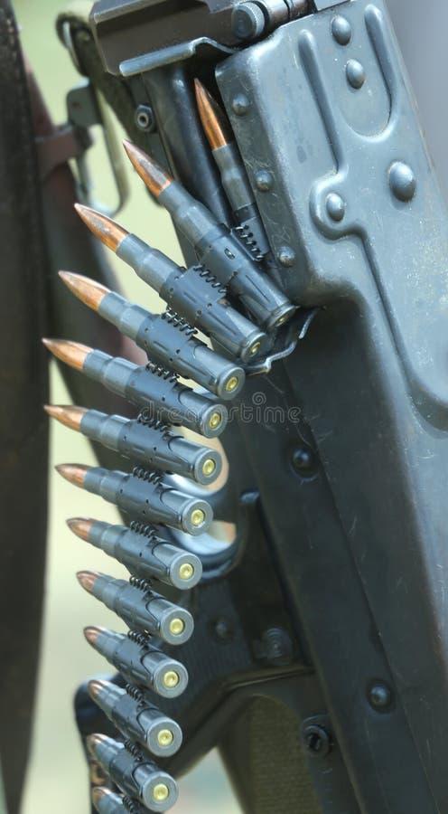 Смертельные пули пулемета строки стоковое фото rf