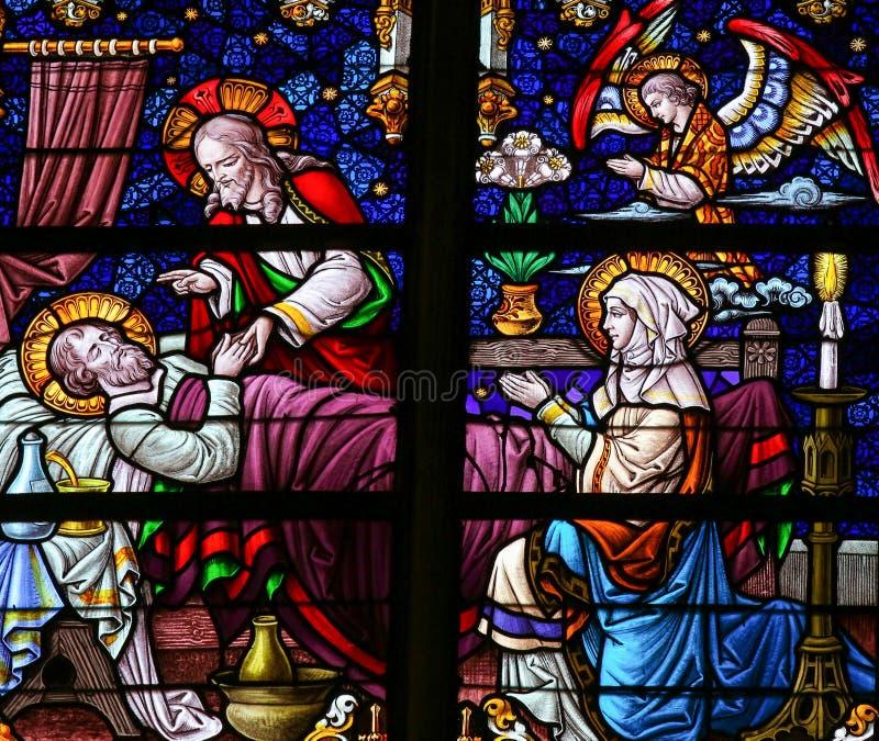 Смертное ложе St Joseph - цветного стекла стоковые фото