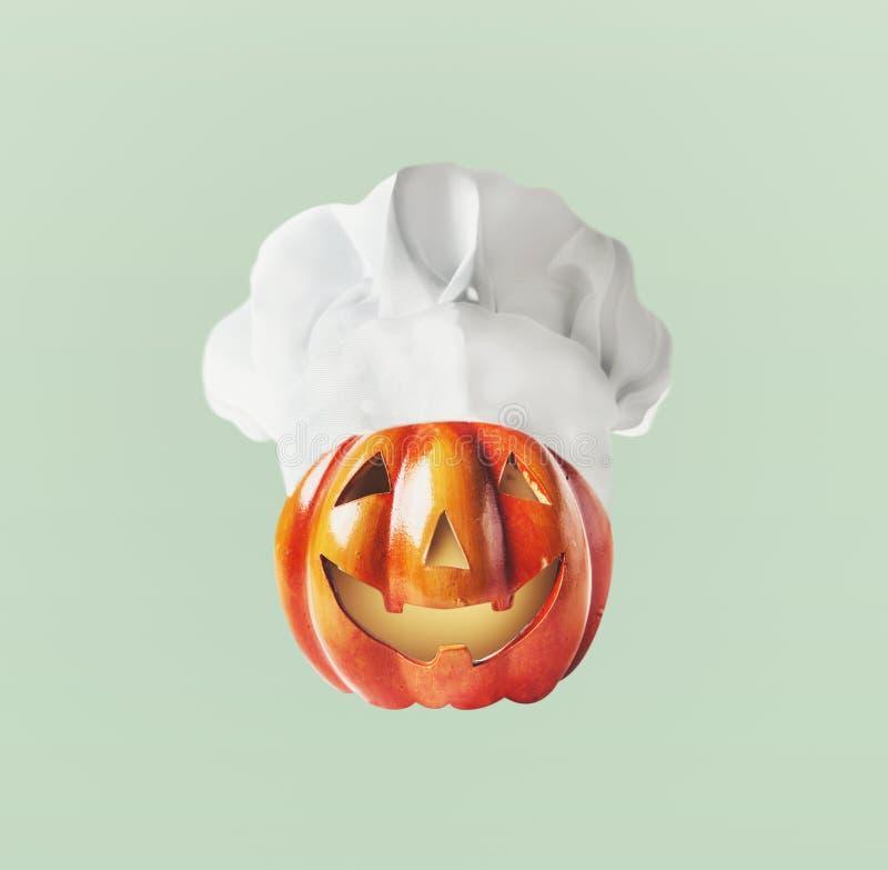 Смешная голова Джека тыквы с шляпой шеф-повара с космосом экземпляра Хеллоуин и благодарение стоковое изображение rf