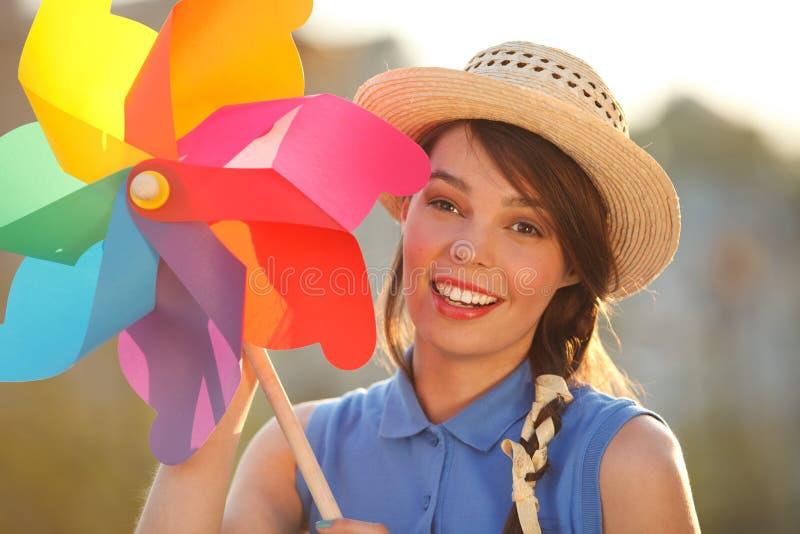 Смешная девушка с лопастью погоды стоковое фото rf