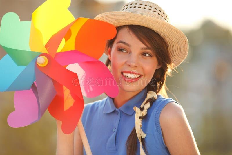 Смешная девушка с лопастью погоды стоковые фотографии rf