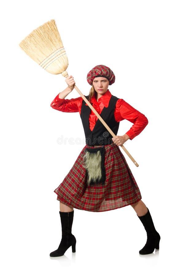 Смешная женщина в шотландской одежде с веником стоковые фото