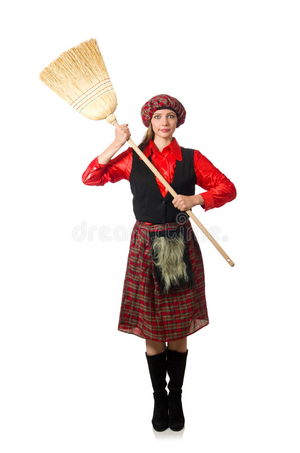 Смешная женщина в шотландской одежде с веником стоковая фотография