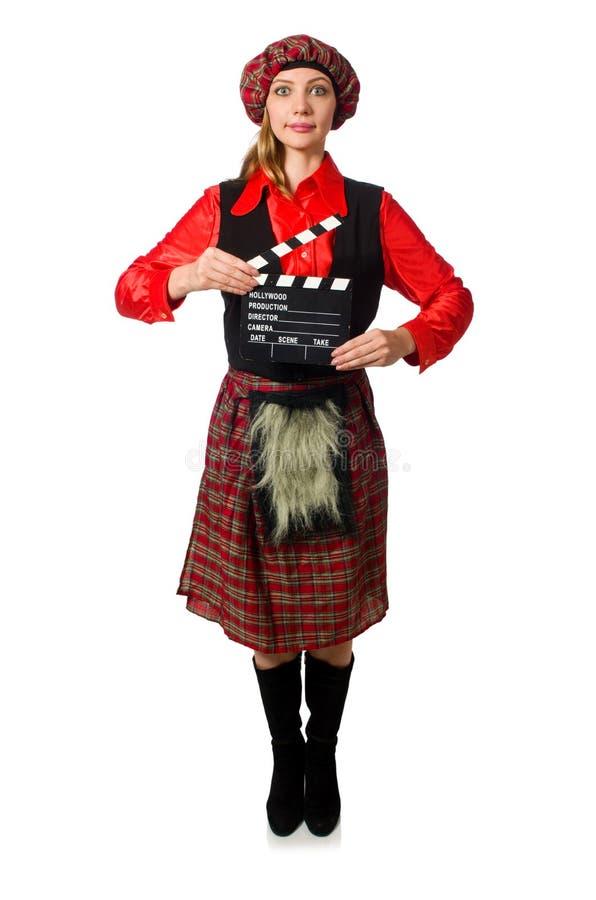 Смешная женщина в шотландской одежде с кино стоковая фотография