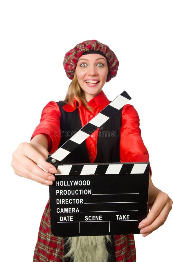 Смешная женщина в шотландской одежде с кино стоковое изображение rf