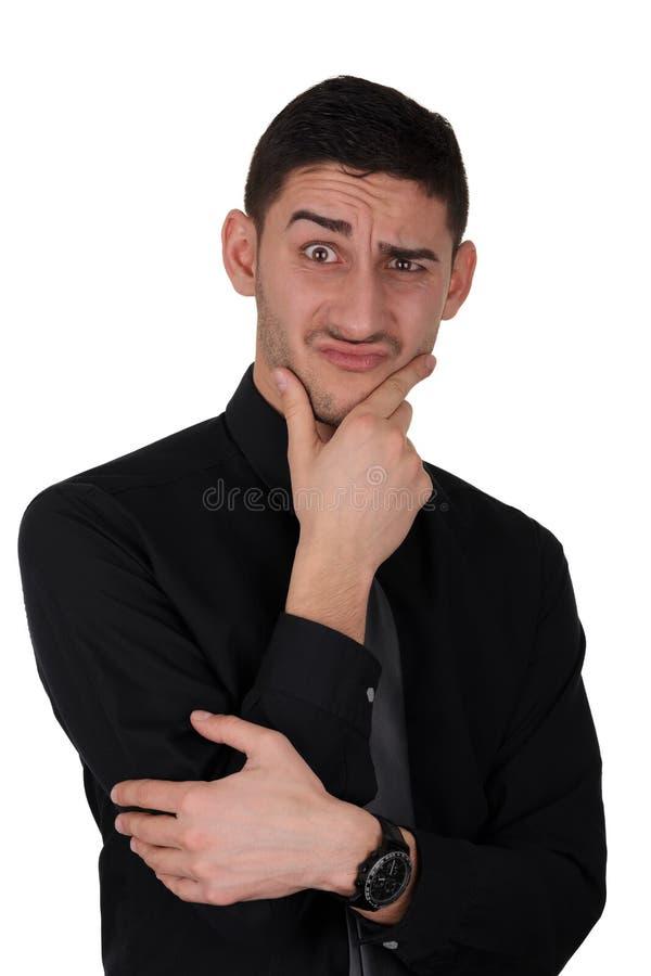 Смешное выражение думать молодого человека стоковые изображения rf