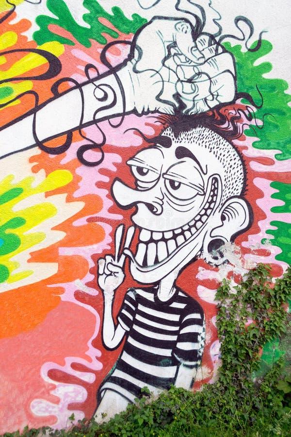 Смешное, глупое искусство граффити характера стоковые фото
