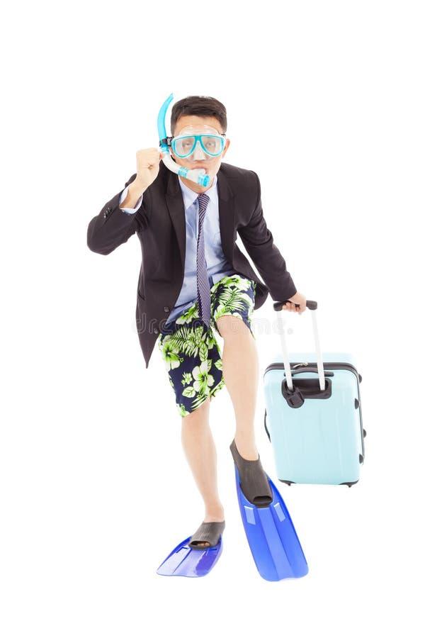 Смешной бизнесмен положил дальше шестерню акваланга и подготавливает для того чтобы побежать стоковые фотографии rf