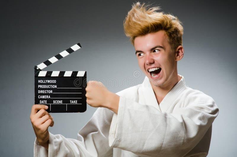 Смешной боец карате в концепции спорт стоковое изображение