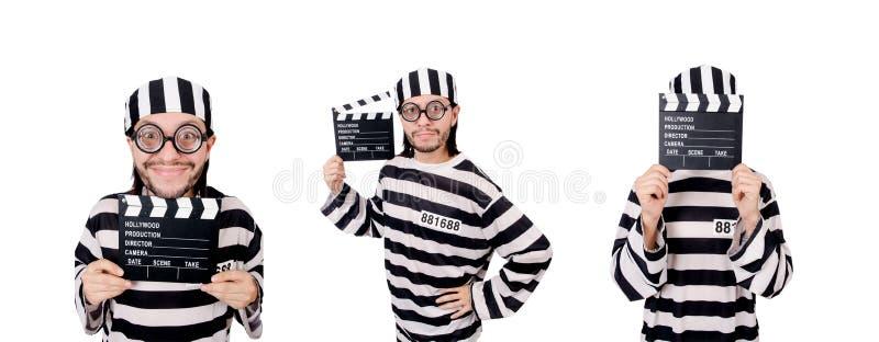 Смешной воспитанник тюрьмы при доска кино изолированная на белизне стоковое фото