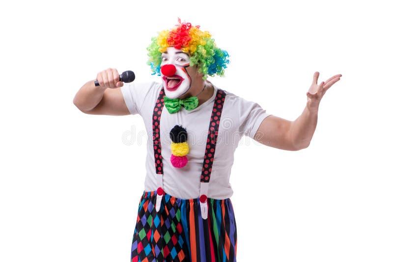 Смешной клоун с караоке петь микрофона изолированный на белизне стоковое фото rf