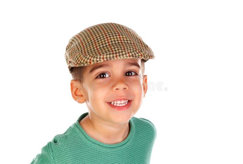Смешной малый ребенок с темными глазами и испанской крышкой стоковые фото