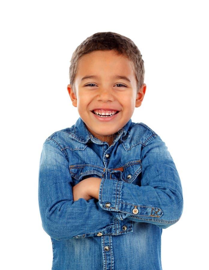Смешной малый ребенок с футболкой джинсовой ткани стоковое изображение rf
