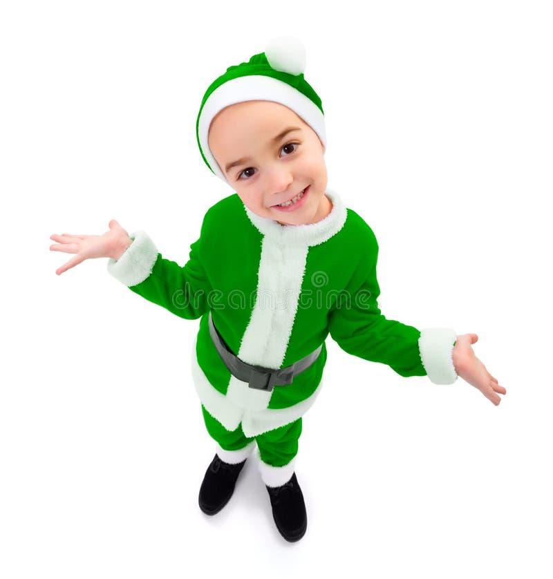 Смешной мальчик нося зеленую форму Санта Клауса стоковое фото rf