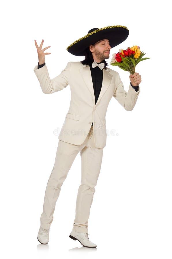 Смешной мексиканец в костюме держа цветки изолированный стоковое изображение