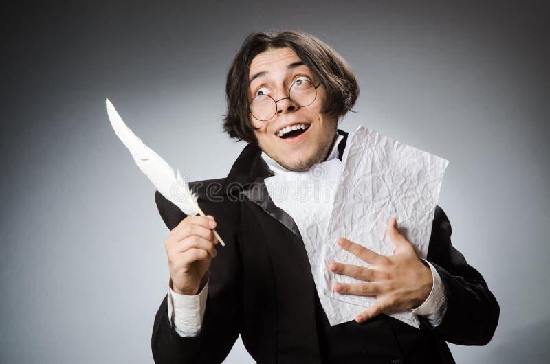 Смешной писатель с quill в винтажной концепции стоковое фото rf
