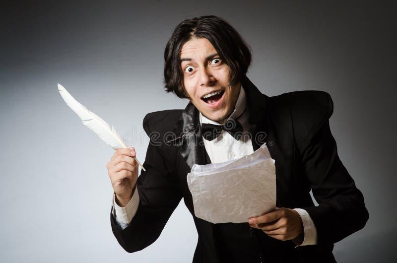 Смешной писатель с quill в винтажной концепции стоковая фотография rf