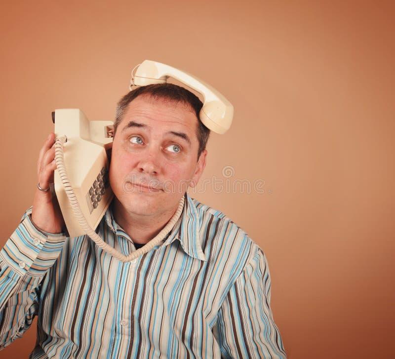 Смешной ретро человек телефона стоковое изображение rf