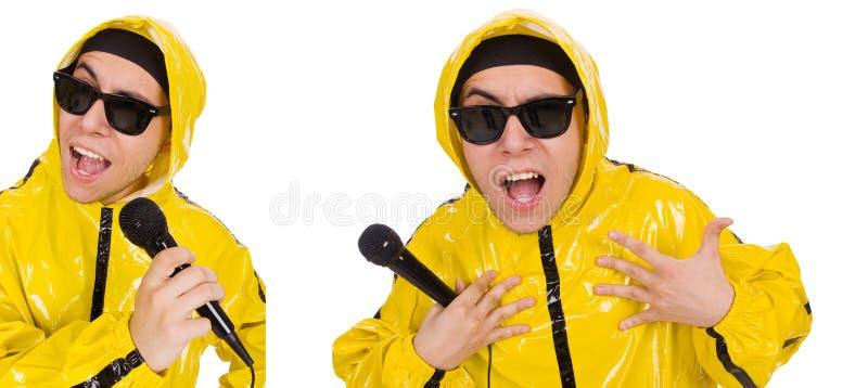 Смешной совершитель при mic изолированный на белизне стоковое изображение