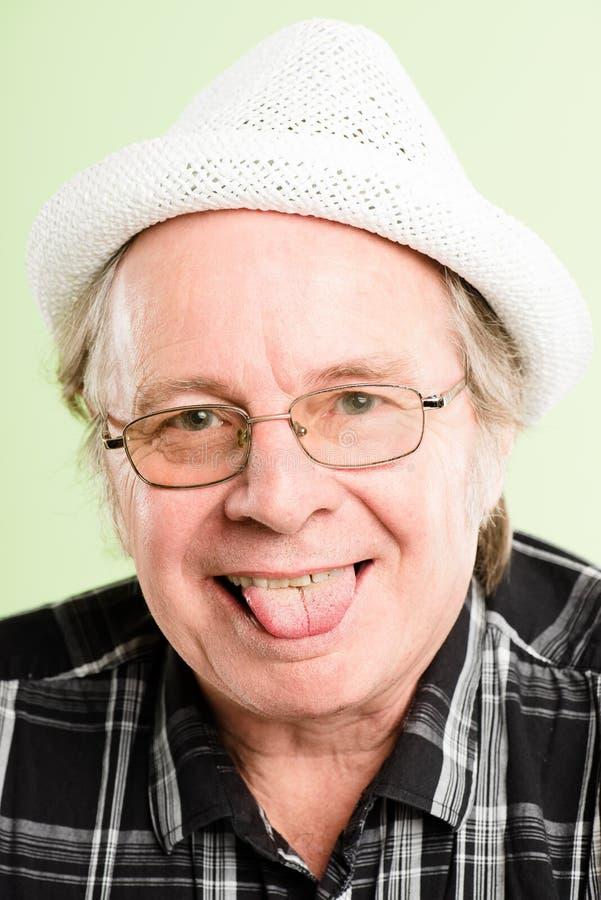 Предпосылка зеленого цвета определения смешных людей портрета человека реальных высокая стоковая фотография