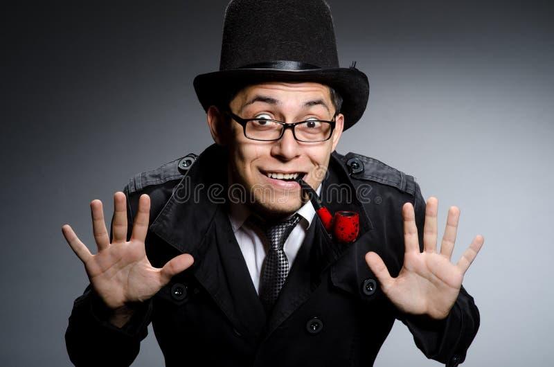 Смешной сыщик с трубой стоковое фото rf