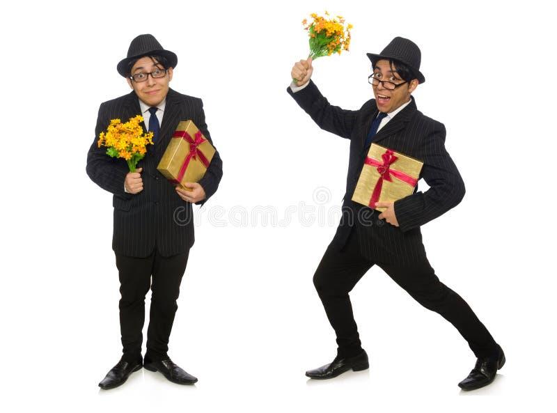 Смешной человек с цветками и giftbox стоковое фото rf