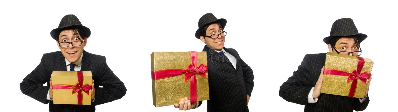 Смешной человек с giftbox на белизне стоковое фото rf