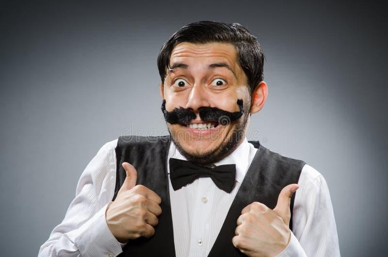 Смешной человек в винтажной концепции стоковое фото